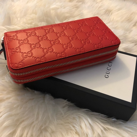 32c11e0555b Gucci Handbags - Gucci leather double zip around wallet red